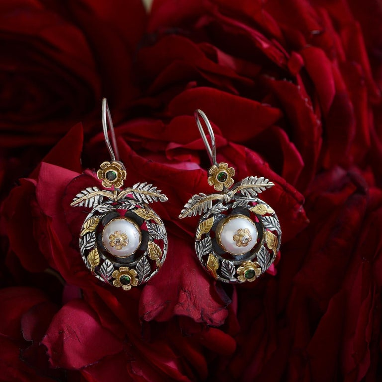 These exquisite one of a kind Emma Chapman Pearl Diamond Tsavorite 18kt Gold Dangle Earrings, have been handmade in our workshops.  They feature pearls which are embedded with full cut diamonds set in an 18kt gold flower. The earrings also have