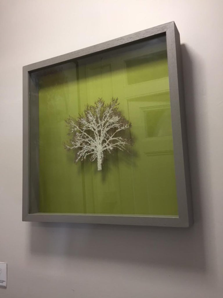 Moss Tree, Crystal Glitter Oak by Emma Levine. 53cm x 53cm – Framed in a grey wooden frame and ready to hang. Silk, paper, entomology pins and Swarovski crystals.  Signed in the bottom right hand corner.