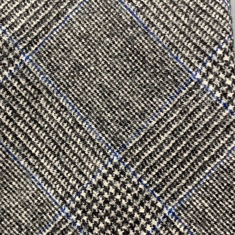 EMMA WILLIS necktie comes in heathered gray wool cashmere blend flannel with all over black and blue glenplaid print. Made in England.  Excellent Pre-Owned Condition.  Width: 4 in.