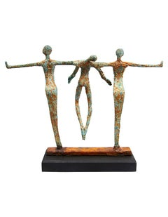 Balance -  Emmanuel Okoro Bronze Resin sculpture of 2 figures holding a third