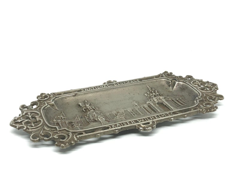 Beautiful metal tray or catchall to hold quills. Made of cast Iron, has some nice patina, but this is old-age. A beautiful piece for your desk or any room. It was made for the 100th year anniversary of the National Monument 1797-1897 in Berlin,