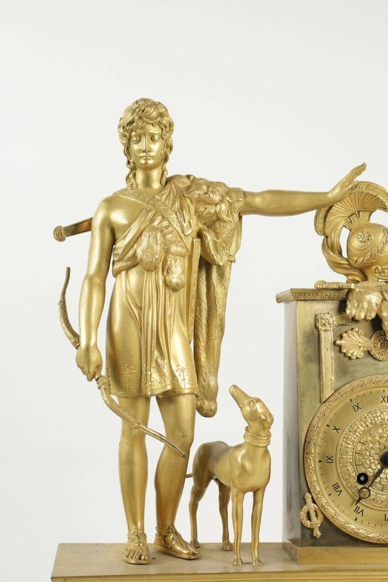 Empire clock from the 19th century in gold gilt bronze.  Measure: L 39cm, H 54cm, P 13cm.