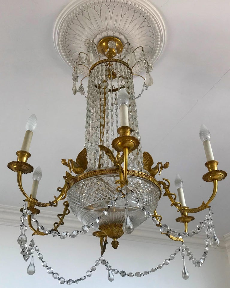 Finely chiseled gilt bronze and cut crystal Empire elegant chandelier with six arms. Six E 14 light bulbs.