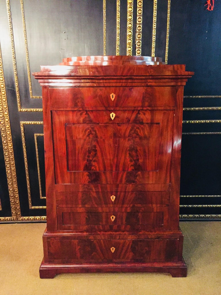 Very well preserved conical secretary with stepped head Front with multiply mirrored pyramid mahogany entire surface with original shellac hand polish high-quality cabinet part with thread intarsia and leg buttons very elaborate workmanship and
