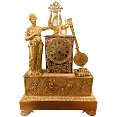 Empire Pendulum Clock, First Half of the 19th Century Fire-Gilded, Standing Lady