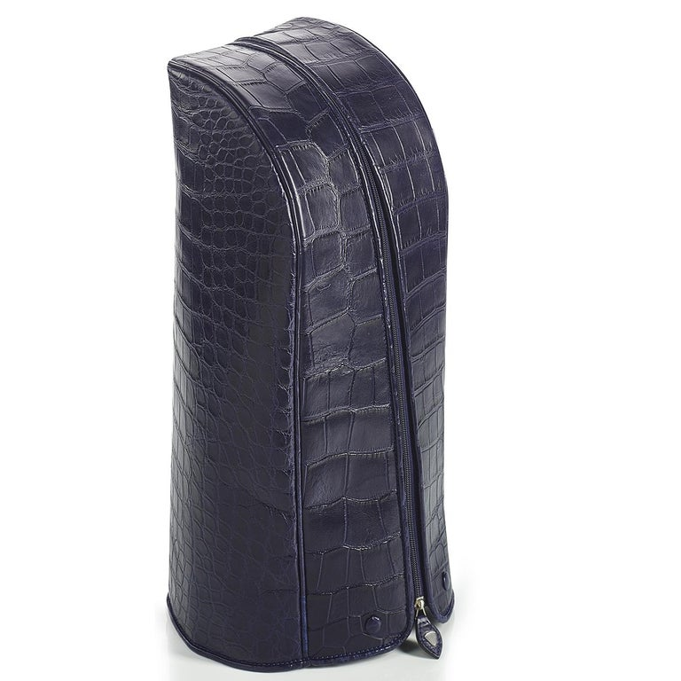 A superb addition to afternoon with friends and family, this stunning golf bag is part of the Empire collection. It was exquisitely handcrafted of crocodile and carbon fiber and tinted with a deep royal blue shade. It is equipped with hardware