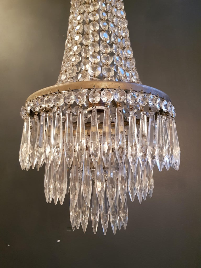 Original preserved chandelier, circa 1930. Cabling and sockets completely renewed. Crystal hand-knotted Measures: Total height: 99 cm, height without chain: 70 cm, diameter 25 cm, weight (approximately) 4 kg.  Number of lights: One-light bulb