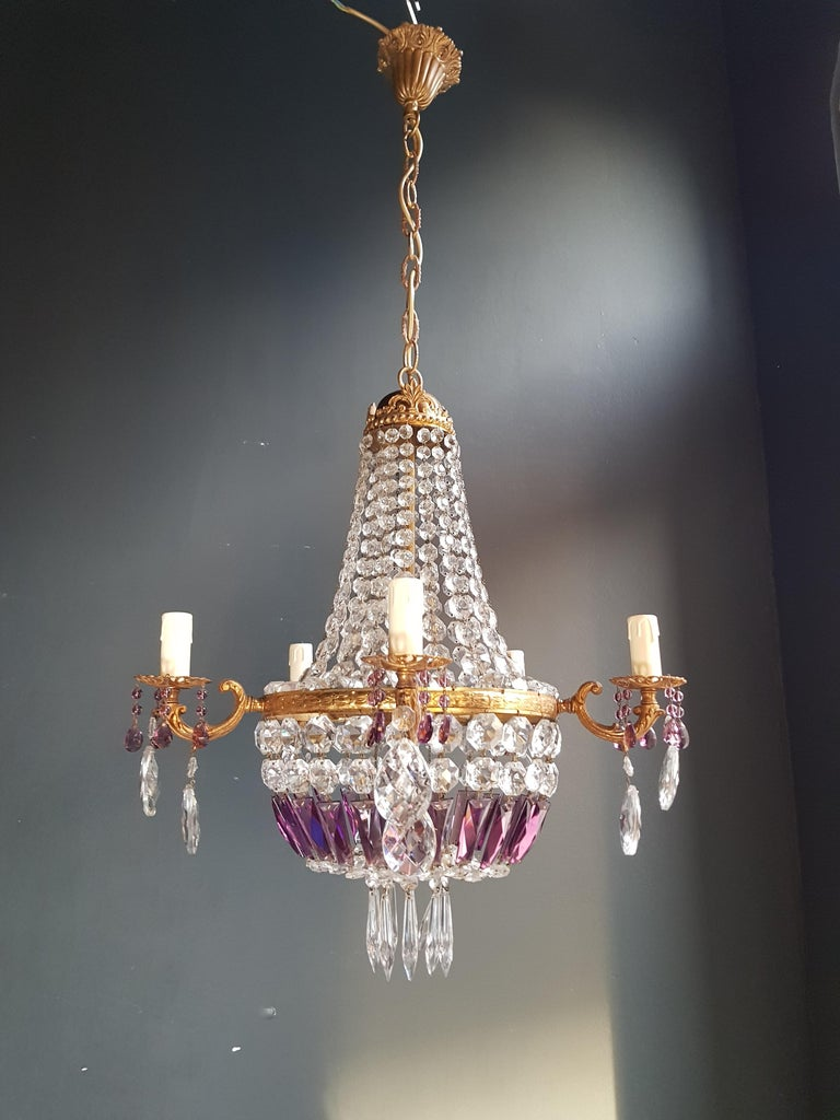 Original preserved chandelier, circa 1930. Cabling and sockets completely renewed. Crystal hand knotted. Measures: Total height: 99 cm, height without chain: 61 cm, diameter 52 cm, weight (approximately) 7 kg.  Number of lights: Six-light bulb