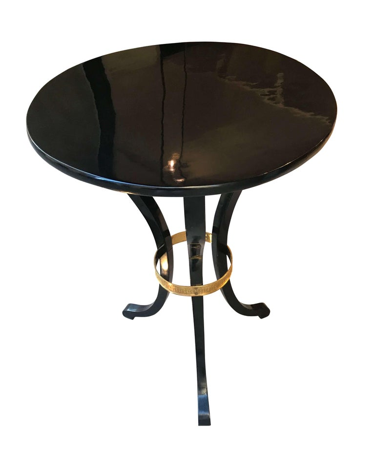 Elegant Empire side table from Vienna, Austria, circa 1815.  Three curved legs with finely chased original brass rim.  Wood: Black polished maple, ebonized and hand polished with shellac (French Polish).
