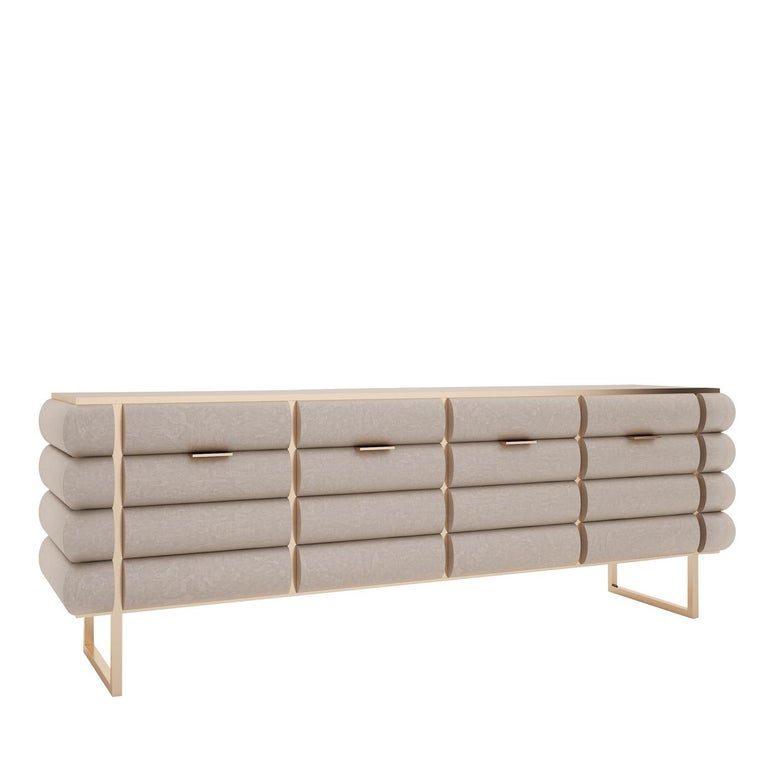 The lavish yet sophisticated flair characterizing this sideboard makes it perfect to be a versatile furniture piece. Sitting atop a brass-finished, light metal base, its wooden silhouette comprises four wide compartments and its surface is enlivened
