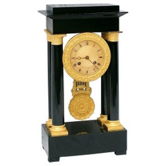 Empire Style Black and Golden Bronze Table Clock, France, 19th Century