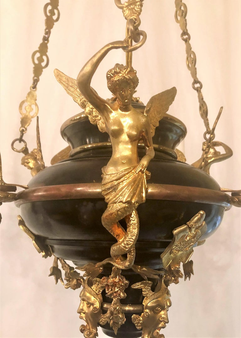 Empire style bronze chandelier with fine detailing.