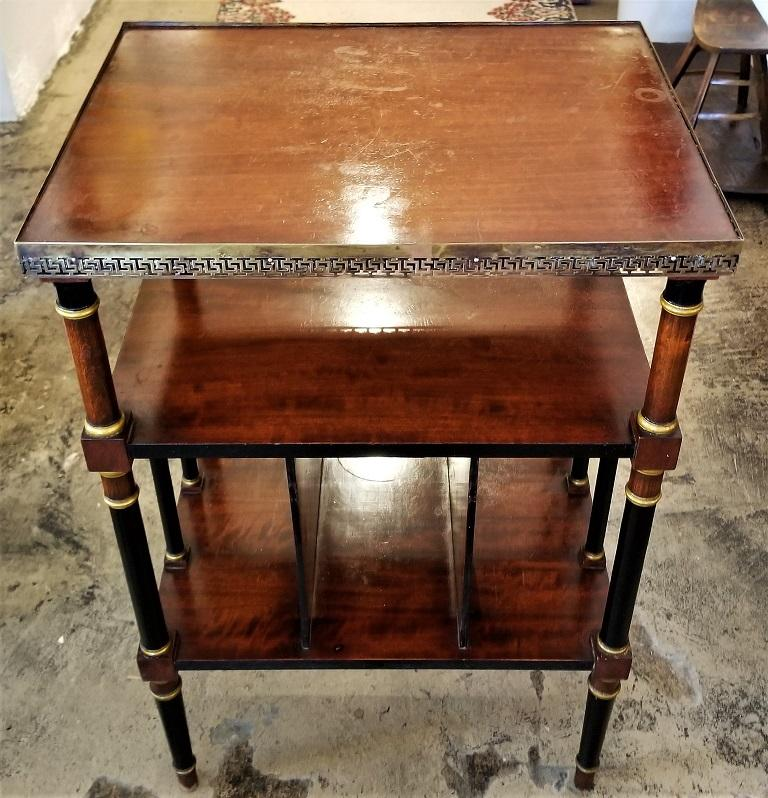 Presenting a beautifulEmpire style Canterbury side table.  Made of flame mahogany, ebony and gilt and brass banding.  The table has a frieze gallaried top edged in Grecian themed pierced brass molding.  It has four supporting columns on each