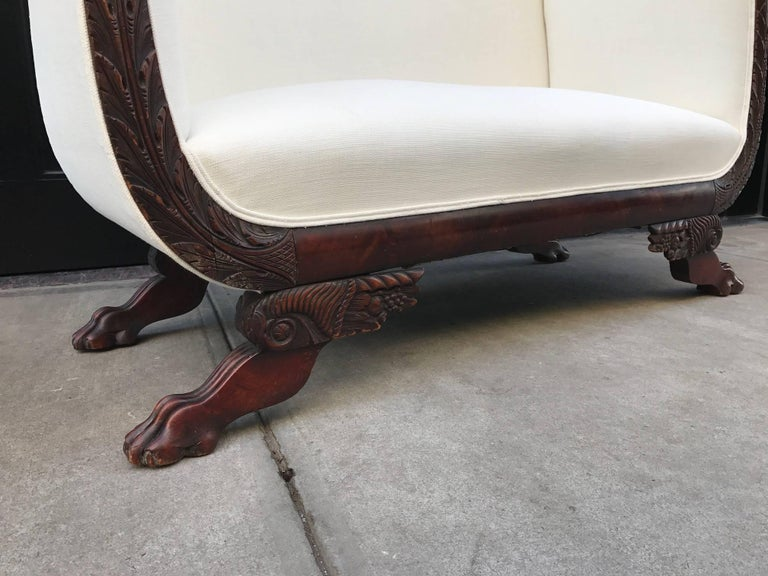 Early 20th Century Empire Style Tall Back Loveseat with Carved Mahogany Base For Sale