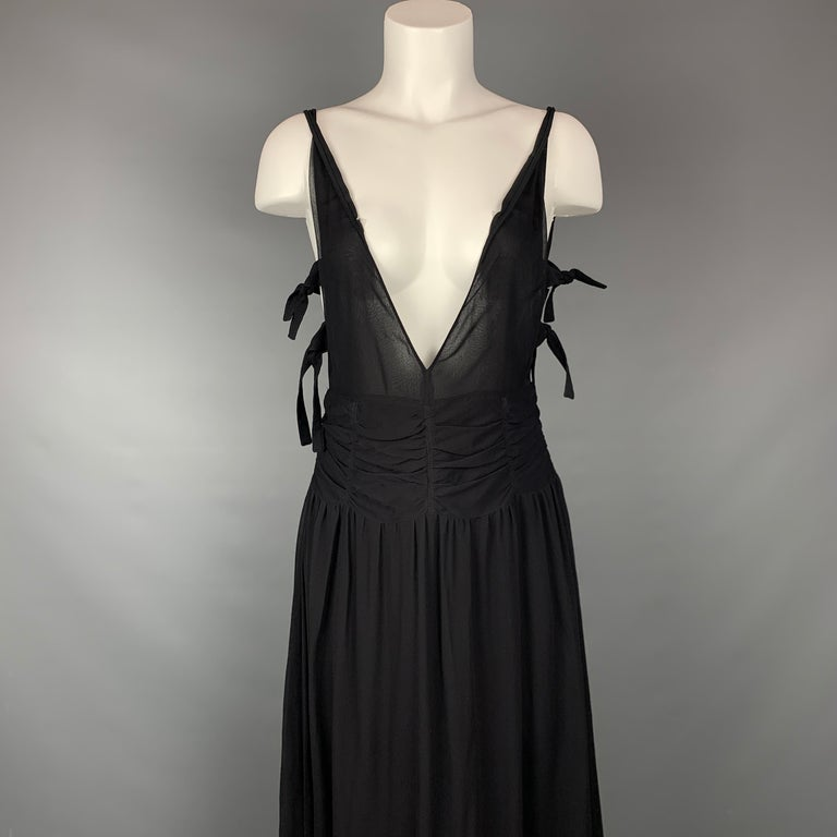 EMPORIO ARMANI 2002 gown comes in a black chiffon material featuring an a-line style, ruched design, side tie details, plunging v-neck, and a back zip up closure. Made in Italy.  Very Good Pre-Owned Condition. Marked: 42  Measurements:  Bust: 28