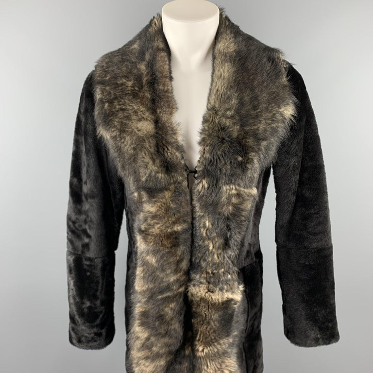 EMPORIO ARMANI coat comes in a brown sheep skin shearling featuring a shawl collar design, slit pockets, and a hook & eye closure.  Excellent Pre-Owned Condition. Marked: No size marked  Measurements:  Shoulder: 18 in.  Chest: 40 in.  Sleeve: 27 in.