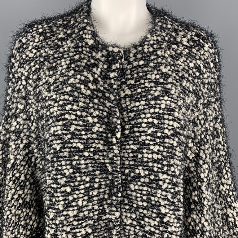 EMPORIO ARMANI coat comes in black and white chunky knit with tinsel fringe throughout, round neckline, cropped sleeves, and snap closures.   Excellent Pre-Owned Condition. Marked: M  Measurements:  Shoulder: 18 in. Bust: 52 in. Sleeve: 20