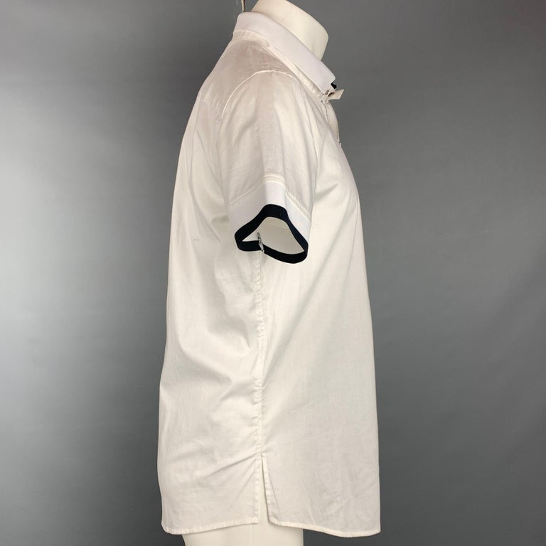 EMPORIO ARMANI short sleeve shirt comes in a white cotton featuring a ribbed hem, black trim, front pocket, spread collar, and a zip up closure.   New With Tags.  Marked: M  Measurements:  Shoulder: 18 in. Chest: 40 in. Sleeve: 8.5 in. Length: 28