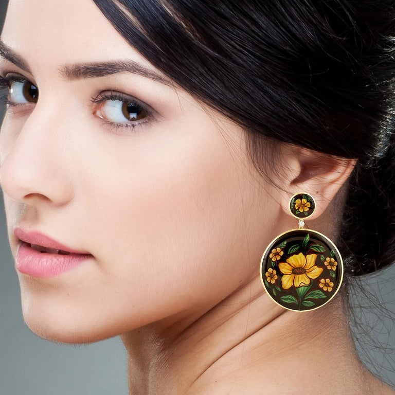 These beautiful earrings features unique hand painted miniature art set in 18K gold.  It is set in 56.15 carats bakelite & .15 carats diamonds.  FOLLOW  MEGHNA JEWELS storefront to view the latest collection & exclusive pieces.  Meghna Jewels is