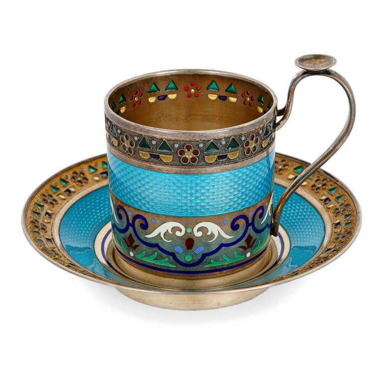 This set contains ten saucers, ten coffee cups, and ten teaspoons, providing a ten-person coffee service. All the pieces are vermeil (gilded silver) and are marked accordingly with silver marks, the mark of the maker (11th Artel), and export