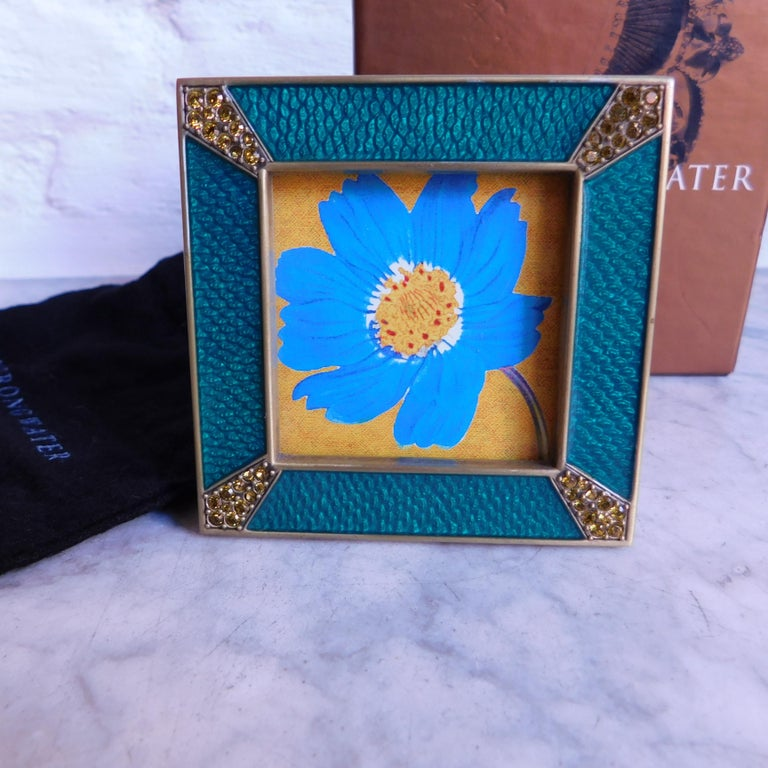 Jay Strongwater Frame from the Leland collection. Hand enameled in turquoise blue and hand set with deep golden yellow Swarovski crystals.