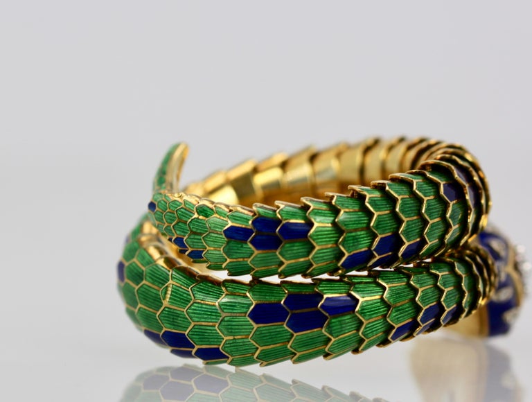 This enamel articulated Snake bracelet is by far my favorite.  This bracelet is knock down gorgeous.  As you can see I own lot's of snake bracelets but this one is the best I have ever had.  As for the articulated body it is perfect with only the