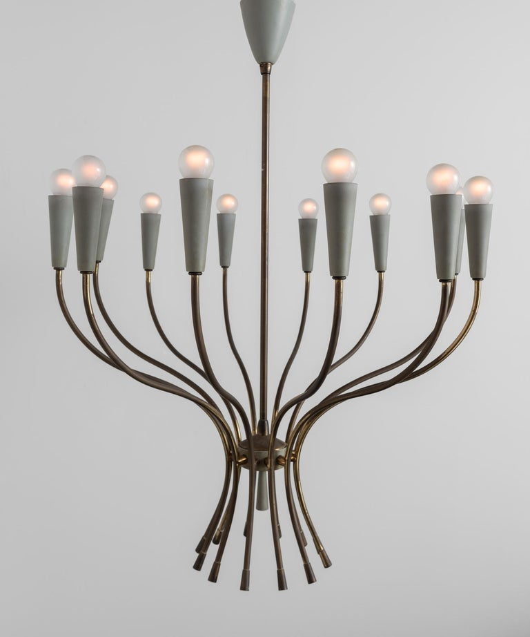 Enamel and brass modern chandelier, Italy, 1960.  12-arm modern chandelier with graceful form, and original pale green painted shades.