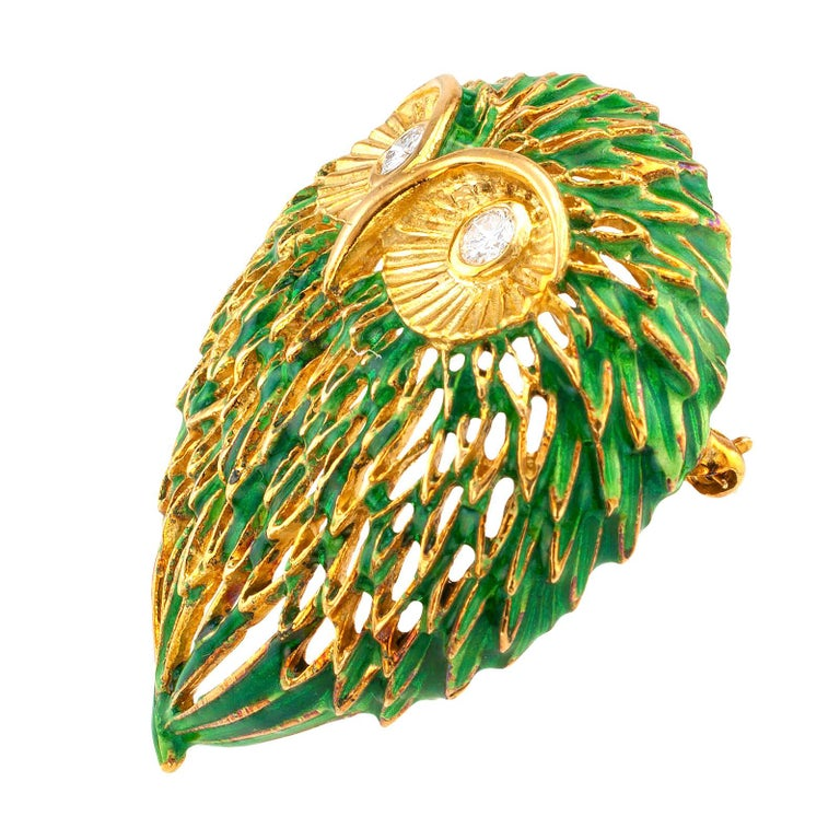 Enamel and diamond  gold Owl brooch circa 1970.  DETAILS: DIAMONDS: two round brilliant-cut diamonds totaling approximately 0.25 carat, approximately G color, VS clarity. METAL: 18-karat yellow gold with green enamel. MEASUREMENTS: approximately