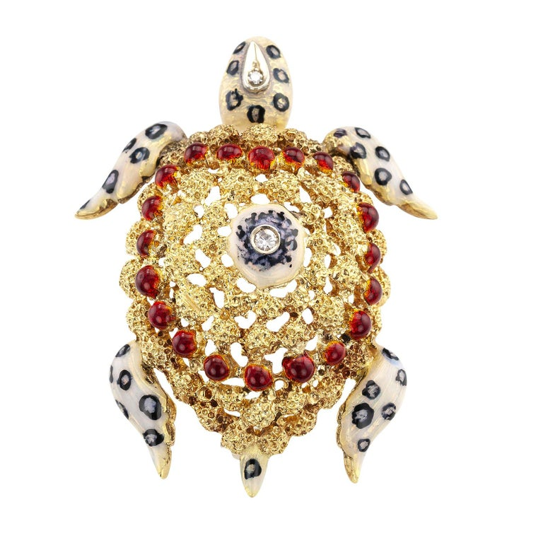 Enamel and diamond gold sea turtle brooch circa 1970.  DETAILS:  DIAMONDS: two round single-cut diamonds totaling approximately 0.04 carat.  METAL: 18-karat yellow gold applied with dark blue, reddish and white enamel.  MEASUREMENTS: approximately