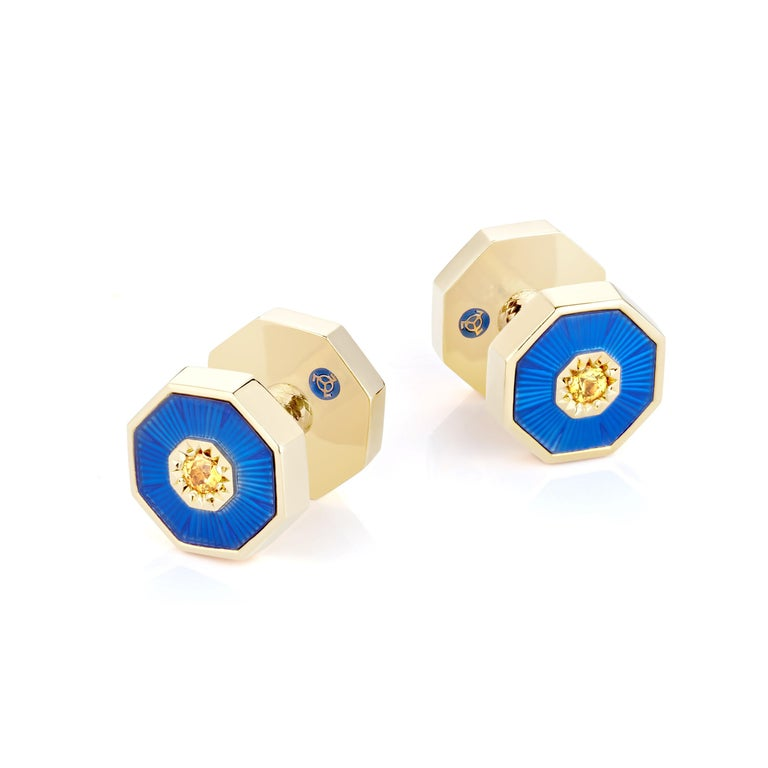 These luxurious 18K solid gold cufflinks are double-sided, set with natural yellow sapphires, and finished with royal blue guilloche enamel. Two parts connect to each other via a screw mechanism. Dome elements remind of the splendorous and geometric