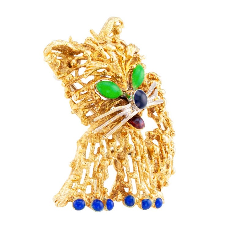 Enamel and gold cat brooch circa 1970. The whimsical design depicts a very excited, happy cat, its eyes, nose and tongue colored with enamel, with beaded open work throughout the head, body and tail, bright blue enameled toenails, crafted in
