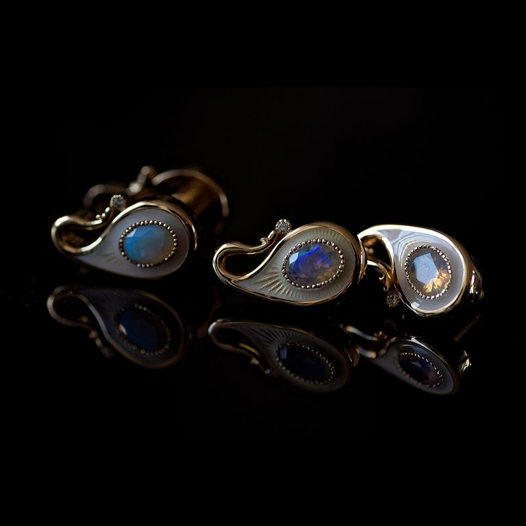 These luxurious 18K solid gold cufflinks are double-sided, set with opals and diamonds, and finished with milky white guilloche enamel. Two parts connect to each other via a custom gold screw mechanism. Paisley symbol reminds the wearer of the