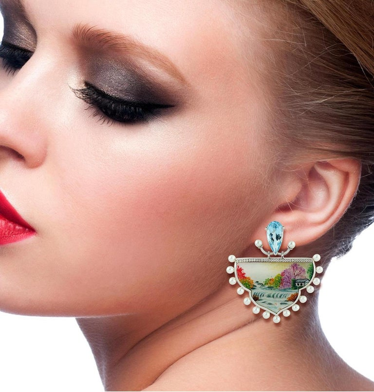 These beautiful Fall Enamel earrings features unique hand painted miniature art set on 36.15 carats of Mother of Pearl. Handcrafted in 18K gold & 0.37 carats glimmering diamonds.   Please note that carat weights may slightly vary as each Meghna
