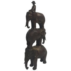 Enchanting Bronze Sculpture of a Man Riding Three Elephants
