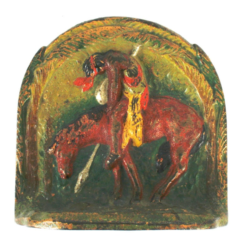 Painted cast iron bookends with the image of the