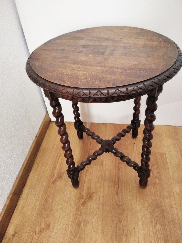 Roundside table features barley twist legs, 18th or 19th century  This table is raised on a base composed of four turned legs and a cross-shaped stretcher, also turned   With his patina, which shows the age of the piece, and its elegant lines  They