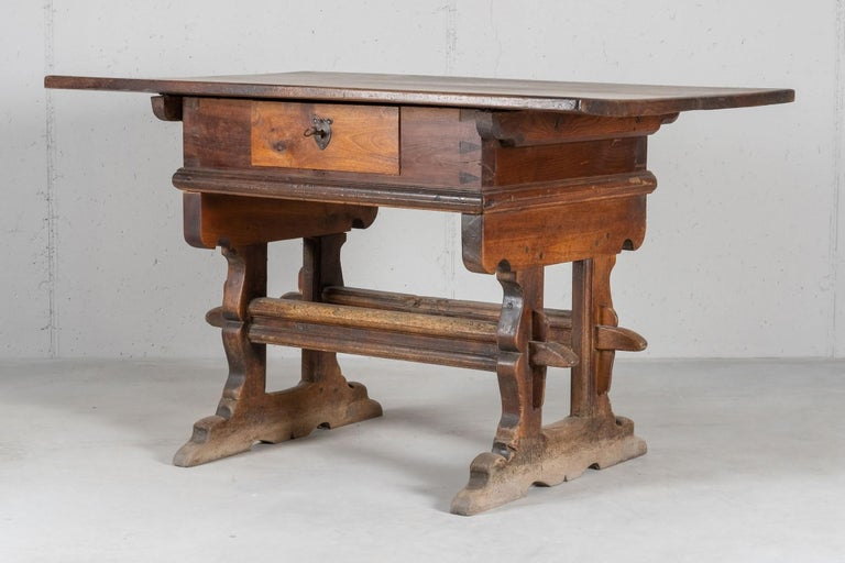 Table typical of the Engadine region in the central south Switzerland. Built in solid walnut in the 17th century, with later modifications.
