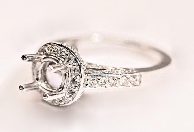 A nice, 14 karat white gold diamond engagement ring. The ring consist of .95 carat total weight of small round brilliant cut diamonds. The diamonds are white in color and VS-SI in clarity. This is a very heavy and substantial ring. The ring will