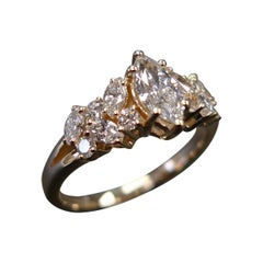 Engagement Ring with Marquise Diamond and Round Brilliant Cut in 18K Rose Gold