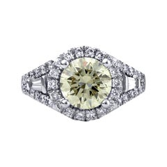 Engagement Ring with Round Cut Center Diamond and Tapered Baguette Side Diamonds