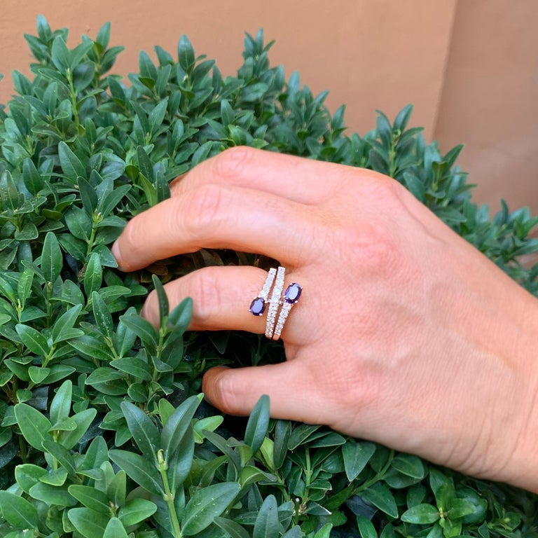 """This elegant renversè ring is set with two beautiful and preciuos oval sapphires, with and  outstanding color, measuring 4x6 mm, followed by 3 rows of degrade diamonds.  Toi et Moi means """"you and me"""" in French, so """"Toi et Moi"""" statement ring is a"""