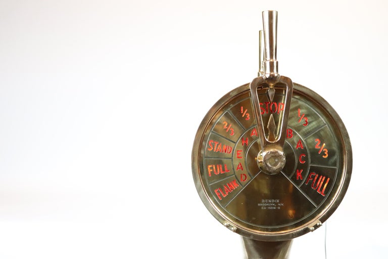 Highly polished engine order telegraph. Dazzling polish on this spectacular relic. With maker name BENDIX, Brooklyn, New York engraved into faceplates. Faceplates have ship commands: Ahead and Back, also stand, Full, Flank, etc. Unit is electrified.
