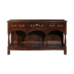 English 1820s Georgian Walnut Dresser Base with Balusters and Arched Apron