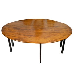 English 1820s Mahogany Drop Leaf Dining Table with Oval Top and Ebonized Legs