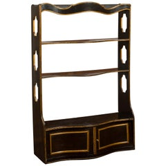 English 1830s Regency Black and Gold Serpentine Front Wall Hanging Shelf