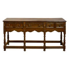 English 1860s Oak Dresser Base with Drawers, Scalloped Apron and Turned Legs
