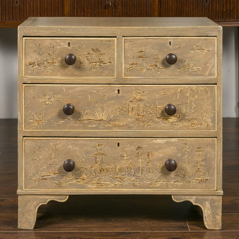 An English chinoiserie painted chest of drawers from the mid-19th century with some original paint and some later painting on ogee bracket feet. Born in England during the third quarter of the 19th century, this painted chest features a rectangular