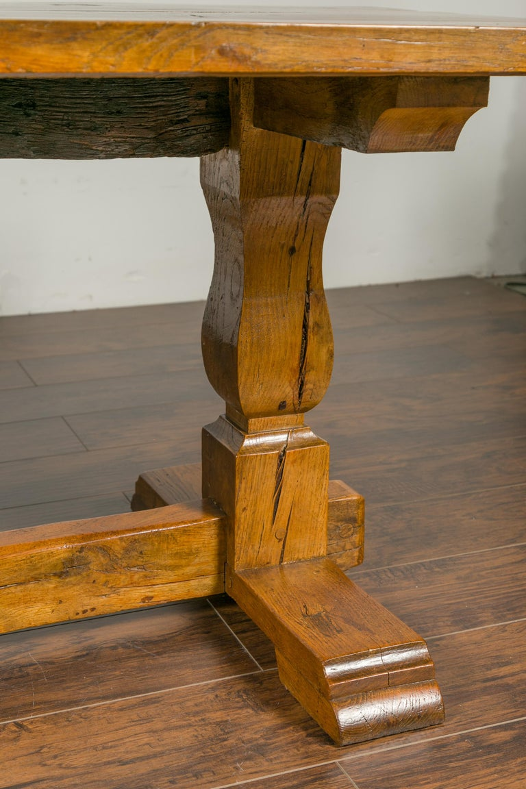 19th Century English 1870s Elm and Walnut Farm Table with Trestle Base and Baluster Legs For Sale