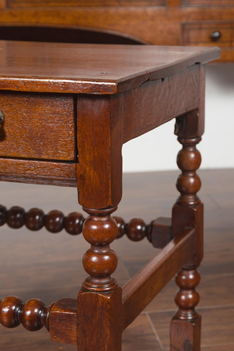 19th Century English 1870s Oak Bobbin Leg Side Table with Single Drawer and Stretchers For Sale