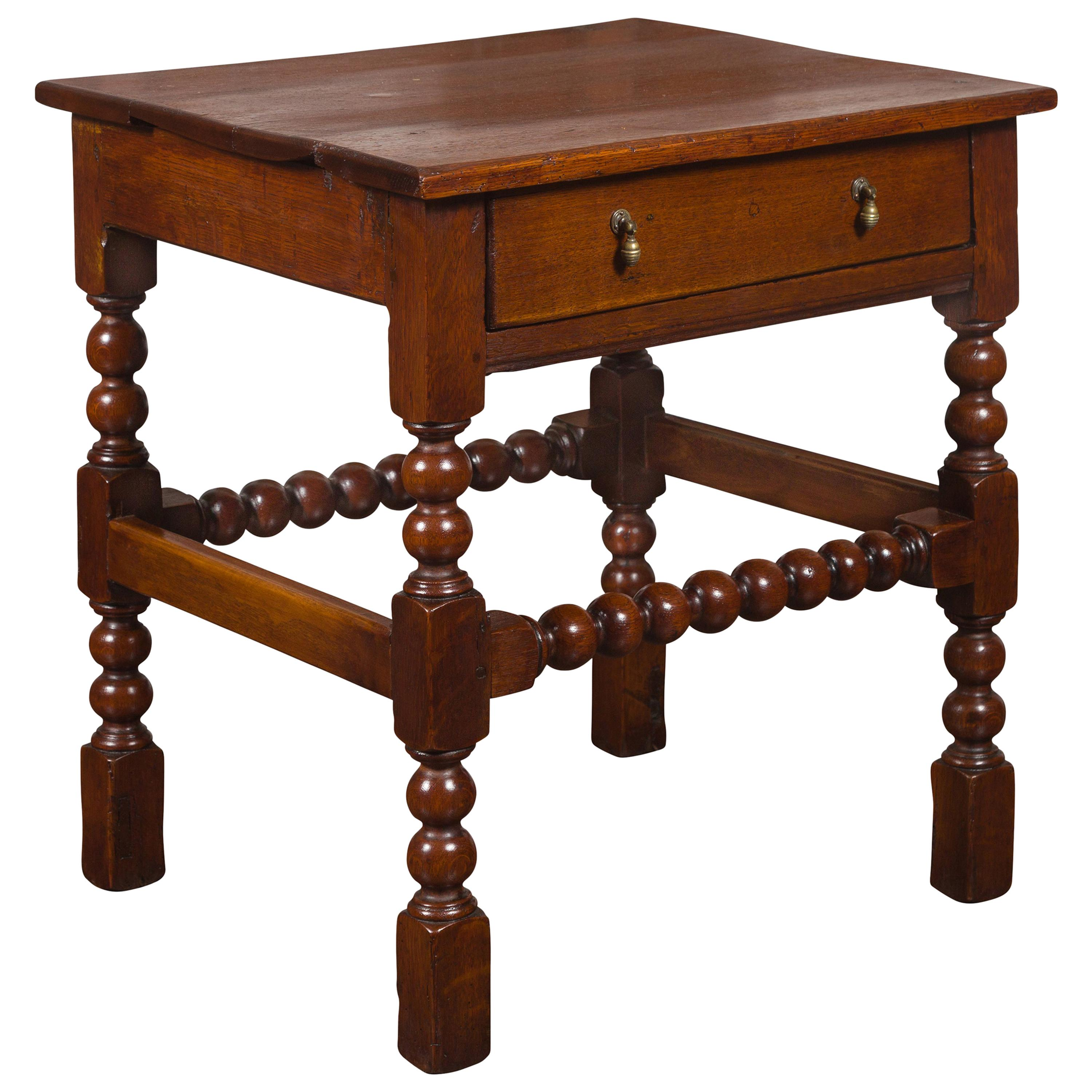 English 1870s Oak Bobbin Leg Side Table with Single Drawer and Stretchers
